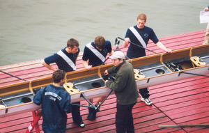 Derek working on a boat with Varsity members company